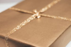 A gift box wrapped in shiny gold paper
