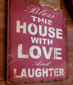 sign that reads bless this house with love and laughter